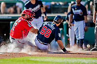 25 February 2019: Washington Nationals catcher Spencer Kieboom unable to get the out at the plate in the 6th inning during a pre-season Spring Training game against the Atlanta Braves at Champion Stadium in the ESPN Wide World of Sports Complex in Kissimmee, Florida. The Braves defeated the Nationals 9-4 in Grapefruit League play in what will be the Braves' last season at the Disney / ESPN Wide World of Sports complex. Mandatory Credit: Ed Wolfstein Photo *** RAW (NEF) Image File Available ***
