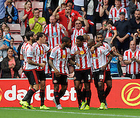 Jermain Defoe (right) of Sunderland celebrates scoring their first goal with team mates during the Barclays Premier League match between Sunderland and Swansea City played at Stadium of Light, Sunderland