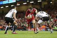 Pictured: Alex Cuthbert of Wales (C) against Josh Matavesi (L) and Nikola Matawalu (R) of Fiji. Saturday 15 November 2014<br />