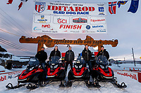 The Iditarod Trail Breakers pose for a photo at the finish line in Nome on Tuesday March 12th during the 2019 Iditarod Trail Sled Dog Race.<br /> <br /> Photo by Jeff Schultz/  (C) 2019  ALL RIGHTS RESERVED