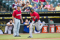 Oklahoma City RedHawks designated hitter Jonathan Villar (6) sprints home during the Pacific Coast League baseball game against the Round Rock Express on August 1, 2014 at the Dell Diamond in Round Rock, Texas. The Express defeated the RedHawks 6-5. (Andrew Woolley/Four Seam Images)