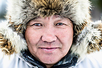 Evenki hunter Ion Maxsimovic.  An explosion of the wolf population has had a devastating impact on the reindeer herds that are the lifeblood for the indigenous Evenki people of the Siberian state of Sakha (Yakutia). In 2012 it was estimated that between 12,000 - 16,000 reindeer were lost to wolf attacks, at a cost of around 15,000 rubles (153.00 GBP) per animal. In response the local authorities introduced a three month hunt with a bounty to encourage hunters to target wolves with the aim of reducing their numbers from 3,500 to 500. Hunters earn 400 USD (280 GBP) per proven kill, plus a further 400 USD (280 GBP) selling the skin to the fur trade. Ion Maksimovic, the region's most celebrated wolf hunter, killed 23 wolves in 2014, more than any other hunter, and in doing so won a prize of 300,000 roubles (3,060 GBP) and a snowmobile.