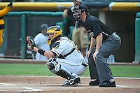 John Buck (14) of the Salt Lake Bees behind the plate with home plate umpire Travis Eggert before the game against the Reno Aces in Pacific Coast League action at Smith's Ballpark on July 24, 2014 in Salt Lake City, Utah.  (Stephen Smith/Four Seam Images)