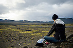 An artist paints the Iceland landscape. This artist was one of the art teachers on the Cape Farewell Youth Expedition organized by the British Council of Canada.