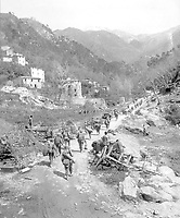 Moving up through Prato, Italy, men of the 370th Infantry Regiment have yet to climb the mountain which lies ahead.  April 9, 1945.  Bull. (Army)<br /> NARA FILE #:  111-SC-205289<br /> WAR & CONFLICT BOOK #:  1030