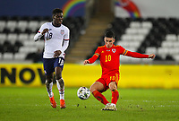12th November 2020; Liberty Stadium, Swansea, Glamorgan, Wales; International Football Friendly; Wales versus United States of America; Harry Wilson of Wales crosses the ball while under pressure from Yunus Musah of USA