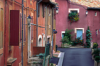 The many hued Ochre colored walls of the  village of ROUSSILLON - PROVENCE, FRANCE