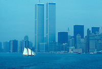 Sailboat in New York harbor with lower Manhattan in the background<br />