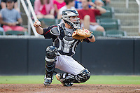 Kannapolis Intimidators catcher Brett Austin (10) during the game against the Charleston RiverDogs at CMC-NorthEast Stadium on June 27, 2014 in Kannapolis, North Carolina.  The Intimidators defeated the RiverDogs 6-5.  (Brian Westerholt/Four Seam Images)