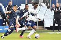 KANSAS CITY, KS - MAY 16: Janio Bikel #19 Vancouver Whitecaps with the ball during a game between Vancouver Whitecaps and Sporting Kansas City at Children's Mercy Park on May 16, 2021 in Kansas City, Kansas.