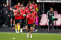 Troy Deeney of Watford (9) leads out the Waford players for the warm up ahead of the Premier League match between Watford and Manchester City at Vicarage Road, Watford, England on 21 July 2020. Football Stadiums around remain empty due to the Covid-19 Pandemic as Government social distancing laws prohibit supporters inside venues resulting in all fixtures being played behind closed doors until further notice.<br /> Photo by Andy Rowland.