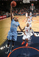 CHARLOTTESVILLE, VA- JANUARY 5: Brittany Rountree #11 of the North Carolina Tar Heels shoots in front of Ariana Moorer #15 of the Virginia Cavaliers during the game on January 5, 2012 at the John Paul Jones arena in Charlottesville, Virginia. North Carolina defeated Virginia 78-73. (Photo by Andrew Shurtleff/Getty Images) *** Local Caption *** Brittany Rountree;Ariana Moorer