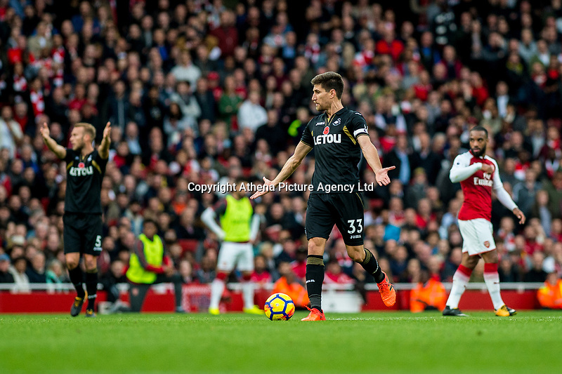 Federico Fernández of Swansea City reacts uring the Premier League match between Arsenal and Swansea City at Emirates stadium, London, England, UK. Saturday 28 October 2017