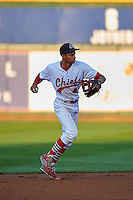 Peoria Chiefs shortstop Oscar Mercado (4) throws to first during a game against the Wisconsin Timber Rattlers on August 21, 2015 at Dozer Park in Peoria, Illinois.  Wisconsin defeated Peoria 2-1.  (Mike Janes/Four Seam Images)