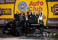 Nov 17, 2019; Pomona, CA, USA; NHRA pro stock motorcycle rider Jianna Salinas celebrates with family after winning the Auto Club Finals at Auto Club Raceway at Pomona. Mandatory Credit: Mark J. Rebilas-USA TODAY Sports
