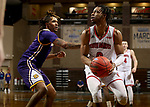 SIOUX FALLS, SD - MARCH 6: Stanley Umude #0 of the South Dakota Coyotes eyes the basket past the defense of Anthony Jones #1 of the Western Illinois Leathernecks during the Summit League Basketball Tournament at the Sanford Pentagon in Sioux Falls, SD. (Photo by Dave Eggen/Inertia)