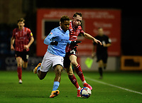 Lincoln City's Theo Archibald vies for possession with Manchester City U21's Jayden Braaf<br /> <br /> Photographer Chris Vaughan/CameraSport<br /> <br /> EFL Papa John's Trophy - Northern Section - Group E - Lincoln City v Manchester City U21 - Tuesday 17th November 2020 - LNER Stadium - Lincoln<br />  <br /> World Copyright © 2020 CameraSport. All rights reserved. 43 Linden Ave. Countesthorpe. Leicester. England. LE8 5PG - Tel: +44 (0) 116 277 4147 - admin@camerasport.com - www.camerasport.com