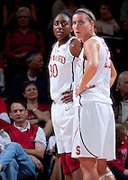 STANFORD, CA - January 22, 2011: Nnemkadi Ogwumike and Jeanette Pohlen of the Stanford women's basketball team during their game against USC at Maples Pavilion. Stanford beat USC 95-51.
