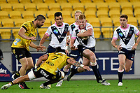 Campbell Magnay of the Melbourne Rebels is tackled during the Super Rugby - Hurricanes v Rebels at Sky Stadium, Wellington, New Zealand on Friday 21 May 2021.<br /> Photo by Masanori Udagawa. <br /> www.photowellington.photoshelter.com