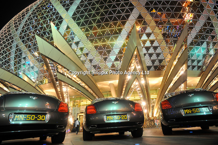 """Luxurious Bentley cars outside The Grand Lisboa in Macau. Macau is known simply as """"Vegas"""" in China. The former Portuguese colony, now a Chinese Special Administrative Region, attracts millions of Chinese gamblers annually and last year earned more gambling dollars than Las Vegas.."""