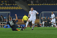 England's Wayne Rooney and U.S. defender Jay DeMerit contest a loose ball during the team's 2010 World Cup debut match. The U.S. and England played to a 1-1 draw in the opening match of Group C play at Rustenburg's Royal Bafokeng Stadium, Saturday, June 12th.