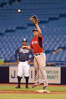 Boston Red Sox first baseman Sam Travis (12) during an Instructional League game against the Tampa Bay Rays on September 25, 2014 at Tropicana Field in St. Petersburg, Florida.  (Mike Janes/Four Seam Images)