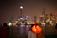 CHINA. Shanghai. Tourists on the Bund. Shanghai is a sprawling metropolis or 15 million people situated in south-east China. It is regarded as the country's showcase in development and modernity in modern China. This rapid development and modernization, never seen before on such a scale has however spawned countless environmental and social problems. 2008