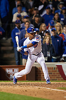 Chicago Cubs Addison Russell (27) hits a single in the ninth inning during Game 4 of the Major League Baseball World Series against the Cleveland Indians on October 29, 2016 at Wrigley Field in Chicago, Illinois.  (Mike Janes/Four Seam Images)