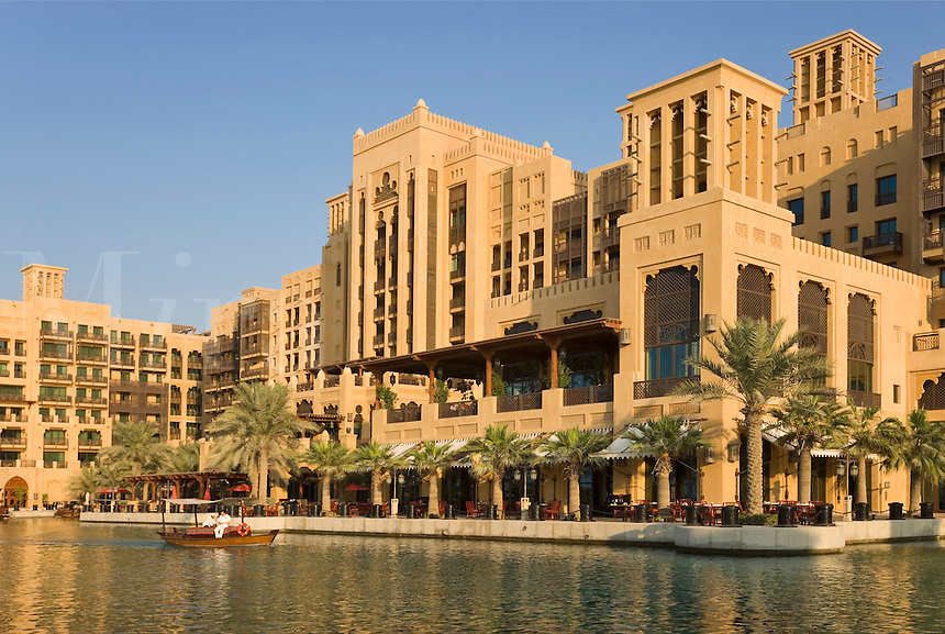 Dubai.  Mina a?Salam Hotel, built in the style of a Moroccan palace, seen over one of the Madinat Jumeirah?s canals with an abra, a water taxi.  .