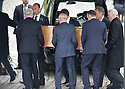 Sandy Jardine's coffin is carried into Mortonhall Crematorium by mourners including former Rangers Chief Executive, Martin Bain and former player, John Greig.