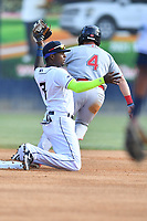Asheville Tourists shortstop Freudis Nova (7) prepares to apply a tag to a hard sliding Cam Cannon (4) during a game against the Greenville Drive on May 19, 2021 at McCormick Field in Asheville, NC. (Tony Farlow/Four Seam Images)
