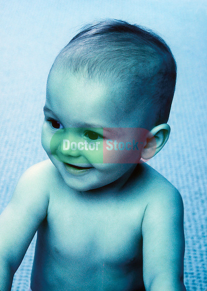 young boy, toddler, sitting up and smiling; cross-processed colors
