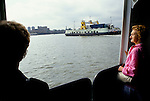 Woolwich ferry. Passengers on board one of the two Woolwich ferry crosses the River Thames East London 1991 1990s