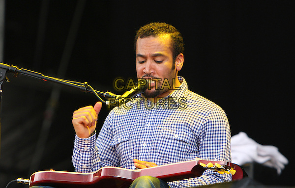 BEN HARPER .Performs during Hard Rock Calling 2009, Hyde Park, London, England, UK,27th June 2009..music concert gig on stage live festival .half length playing guitar microphone beard facial hair blue and white gingham shirt singing .CAP/MAR.©Martin Harris/Capital Pictures