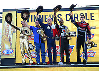 Sept. 23, 2012; Ennis, TX, USA: NHRA (R-L) funny car champion Bob Tasca III, top fuel dragster champion Antron Brown, pro stock champion Allen Johnson and pro stock motorcycle champion Michael Ray celebrate after winning the Fall Nationals at the Texas Motorplex. Mandatory Credit: Mark J. Rebilas-