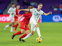 ORLANDO, FL - FEBRUARY 21: Mariana Larroquette #19 of Argentina dribbles during a game between Canada and Argentina at Exploria Stadium on February 21, 2021 in Orlando, Florida.