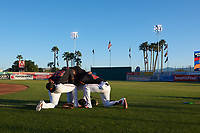 San Jose Giants Manuel Gerardo (26), Heliot Ramos (13), and Jean Angomas (46) pray before a California League game against the Visalia Rawhide on April 12, 2019 at San Jose Municipal Stadium in San Jose, California. Visalia defeated San Jose 6-2. (Zachary Lucy/Four Seam Images)