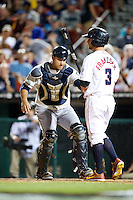 Tacoma Rainers catcher Guillermo Quiroz #18 tags Kevin Frandsen #3 after a dropped third strike during the Triple-A All-Star game featuring the Pacific Coast League and International League top players at Coca-Cola Field on July 11, 2012 in Buffalo, New York.  PCL defeated the IL 3-0.  (Mike Janes/Four Seam Images)
