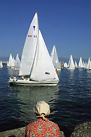 """Switzerland. Geneva. Departure on the lake Geneva of the """"Bol d'Or"""" sailing race. The boats are packed together due to the lack of wind. Yacht racing is a popular sport and the best-known event, the """"Bol d'Or"""" runs from Geneva to the end of the lake and back. Lake Geneva (French: le lac Léman or le Léman) is one of the largest lakes in Western Europe. © 2003 Didier Ruef"""