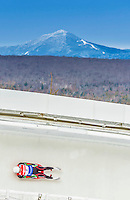 5 December 2014: Stanislav Benyov, sliding for Bulgaria, slides through Curve Number 14 on his first run, ending the day with a 27nd place finish and a combined 2-run time of 1:48.024 in the Men's Competition at the Viessmann Luge World Cup, at the Olympic Sports Track in Lake Placid, New York, USA. Mandatory Credit: Ed Wolfstein Photo *** RAW (NEF) Image File Available ***