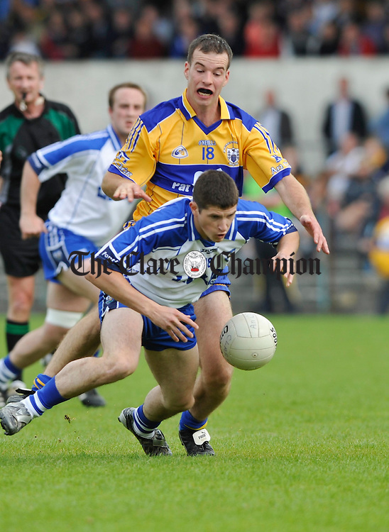 Laurence Healy  keeps an eye on a falling Eamon Walsh of Waterford during their senior championship game in Cusack Park. Photograph by John Kelly.