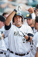 Matt Tuiasosopo (29) of the Charlotte Knights celebrates with teammates after hitting a 2-run home run against the Gwinnett Braves at BB&T Ballpark on August 19, 2014 in Charlotte, North Carolina.  The Braves defeated the Knights 10-5.   (Brian Westerholt/Four Seam Images)