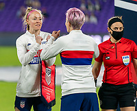 ORLANDO, FL - JANUARY 18: Becky Sauerbrunn #4 fist bumps Megan Rapinoe #15 of the USWNT before a game between Colombia and USWNT at Exploria Stadium on January 18, 2021 in Orlando, Florida.