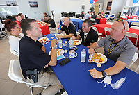 Members of the Fayetteville Police Department eat a lunch Wednesday, September 9, 2020, hosted by McLarty Daniel Chevrolet and catered by the Catfish Hole restaurant at the dealership in Springdale. The dealership hosts the annual 9/11 meal for all emergency responders and military personnel in the northwest Arkansas area in appreciation of their service and commitment to the community. Check out nwaonline.com/200910Daily/ and nwadg.com/photos for a photo gallery.<br /> (NWA Democrat-Gazette/David Gottschalk)
