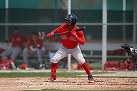 Boston Red Sox Kervin Suarez (16) shows bunt during a Minor League Spring Training game against the Baltimore Orioles on March 20, 2019 at the Buck O'Neil Baseball Complex in Sarasota, Florida.  (Mike Janes/Four Seam Images)