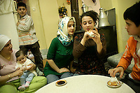 Turkish family telling their fortune in the coffee grinds, Istanbul, Turkey
