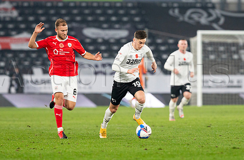 7th November 2020; Pride Park, Derby, East Midlands; English Football League Championship Football, Derby County versus Barnsley; Tom Lawrence of Derby County makes a break with the ball chased by Herbie Kane of Barnsley