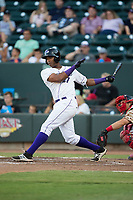 Eloy Jimenez (27) of the Winston-Salem Dash follows through on his swing against the Potomac Nationals at BB&T Ballpark on August 5, 2017 in Winston-Salem, North Carolina.  The Dash defeated the Nationals 6-0.  (Brian Westerholt/Four Seam Images)