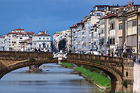 Bridge over the Arno River and downtown architecture, Florence, Italy