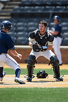 Wake Forest Demon Deacons catcher Ben Breazeale (39) prepares to put the tag on Nico Popa (1) of the Pitt Panthers at David F. Couch Ballpark on May 20, 2017 in Winston-Salem, North Carolina. The Demon Deacons defeated the Panthers 14-4.  (Brian Westerholt/Four Seam Images)